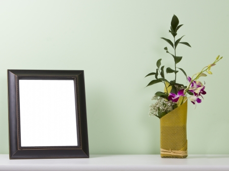 photo frame and flowers on the table