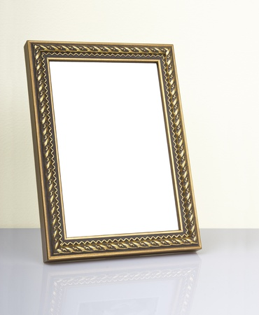 Ornate vintage frame on the table photo