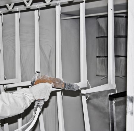 coating: powder coating sprayer in the woker hand Stock Photo