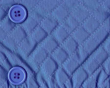 blue material texture with buttons, close up  photo