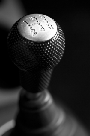 Cars shift lever. Macro shot on chrome gear stick. Gearshift.  photo