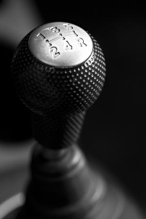Cars shift lever. Macro shot on chrome gear stick. Gearshift.  photo