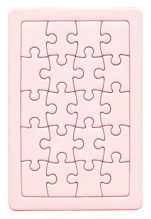 close up of a puzzle game parts, isolated on white background, pink Stock Photo