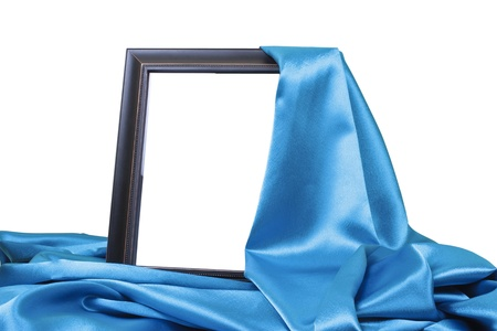 close up of a black wooden frame covered with blue silk on white background with clipping path  photo