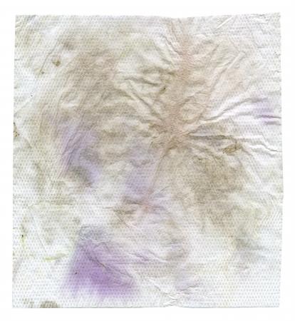cruddy: crumbled dirty napkin isolated on white