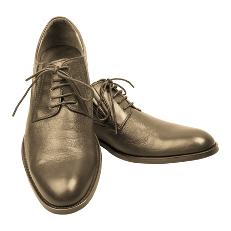 Pair of mans brown shoes isolated on white background
