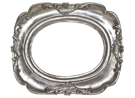 Oval silver picture frame with a decorative pattern  isolated on white background