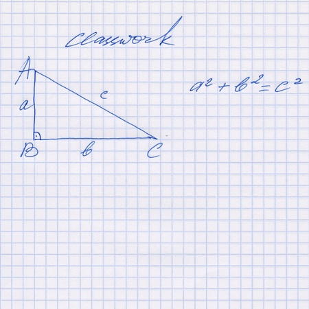 Pythagoras rule explained in the exercise book, Pythagorean theorem sketched on the white squared paper sheet texture or background, Hand drawn pictures