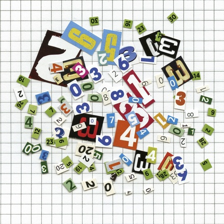 squared: Newspaper, magazine numbers on squared sheet paper as background