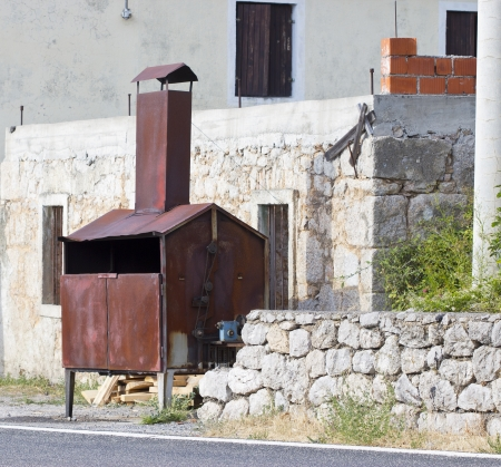 an old brazier grill near the house, Croatia Stock Photo