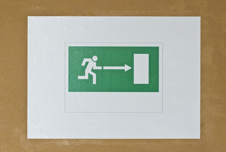 EXIT sign, picture on the wooden background photo