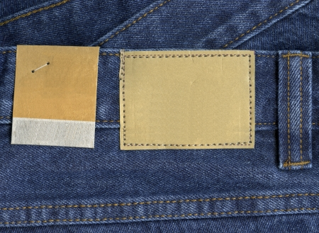 blank leather  and paper jeans labels sewed on jeans. photo