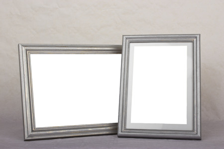 Blank silver picture frames on gray background photo