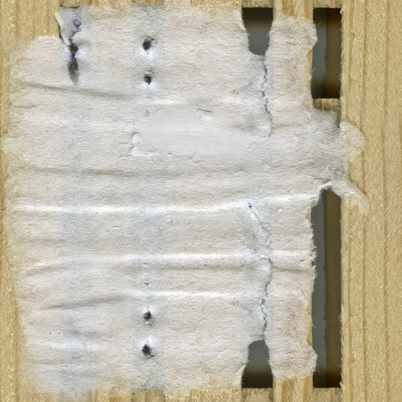 A piece  of old paper on wooden background photo