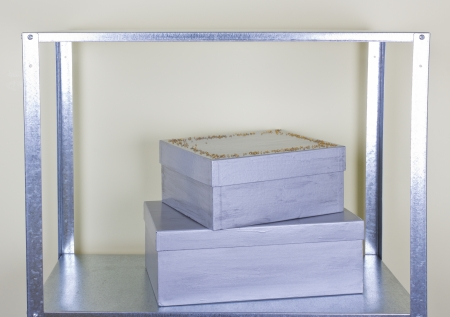 silver boxes on the metal shelf photo