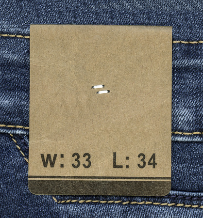 adress: paper tag on jeans background
