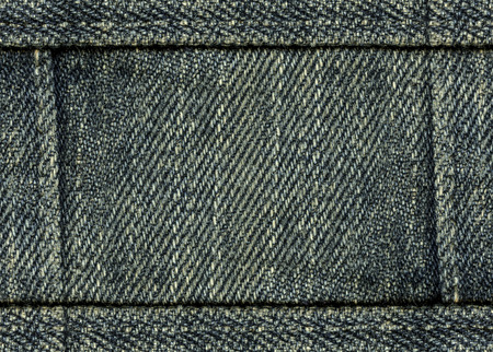seams: gray-blue jeans background, seams in shape of the fram Stock Photo