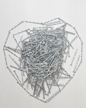 heart made of metal nails