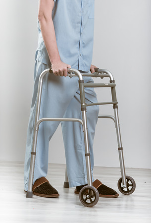 Man with a walker. in the studio photo