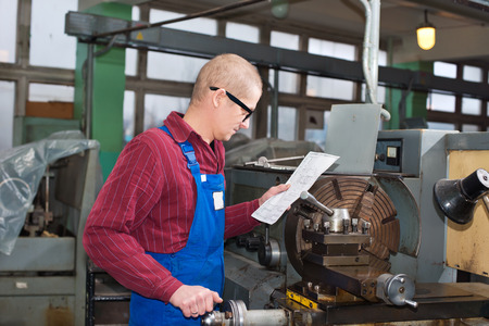 setup operator: Man working for engineering production in the factory
