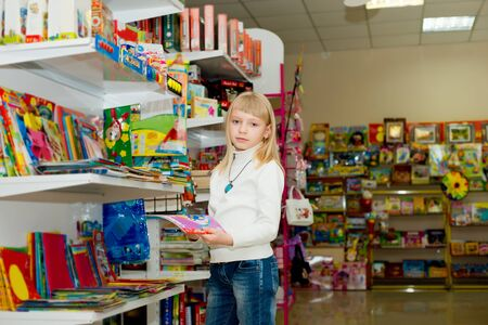 Woman buys school supplies. Girl chooses school supplies Stok Fotoğraf