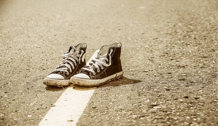 sneakers on the road. road. journey