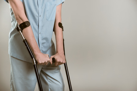 Man with crutches. in the studio Stock Photo