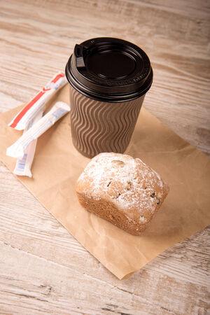 coffee in a paper cup. sugar paper sticks photo