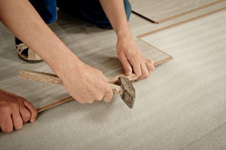 laminate: Installation laminate. focus on the hand. Man puts laminate Stock Photo