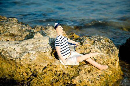 poppet: Doll the tilde on the seashore