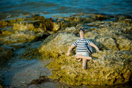 finesse: Doll the tilde on the seashore