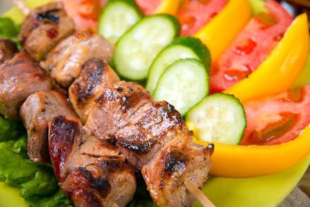 shashlik on a plate. salad and potatoes Stock Photo