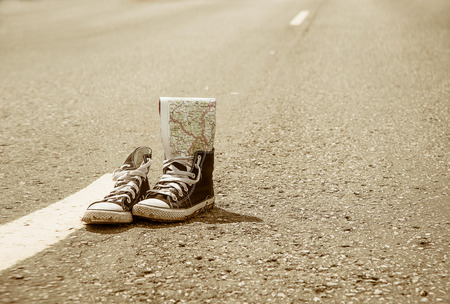 sneakers on the road. road. journey.