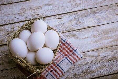 Chicken eggs in the basket.