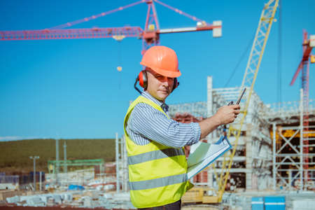 Portrait of a male engineer on a construction site background