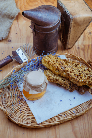 Honeycomb, glass pot with honey, equipment for the beekeeper