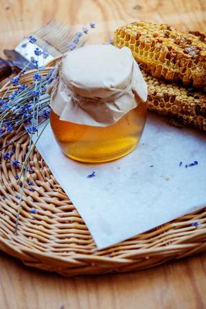 Honeycomb, glass pot with honey Stok Fotoğraf