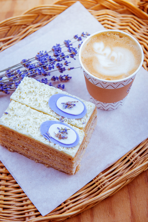 Two slices of cake and coffee in a paper cup Standard-Bild