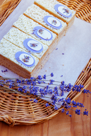 cake and bouquet of lavender on a wooden table