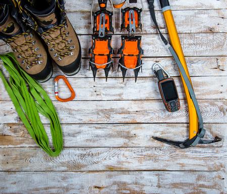 climbing equipment on a wooden background Standard-Bild