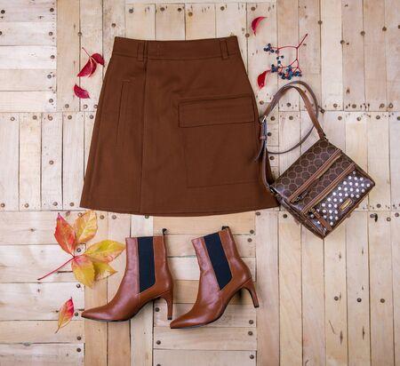 Women's autumn outfit on wooden background Standard-Bild