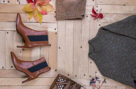 womens autumn clothes, Womens autumn outfit on wooden background Reklamní fotografie