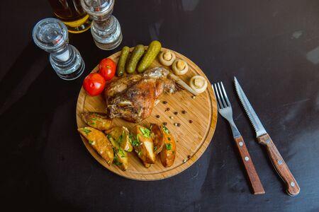 Oven Baked rabbit legs with potatoes Standard-Bild