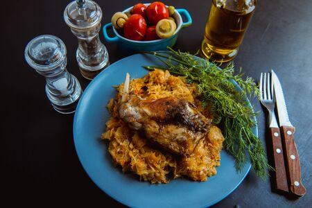 sauerkraut stew with fried meat, fried rabbit