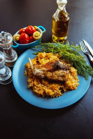 sauerkraut stew with fried meat, fried rabbit