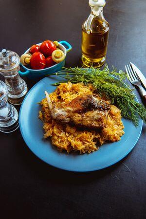 sauerkraut stew with fried meat, fried rabbit Reklamní fotografie - 136253643