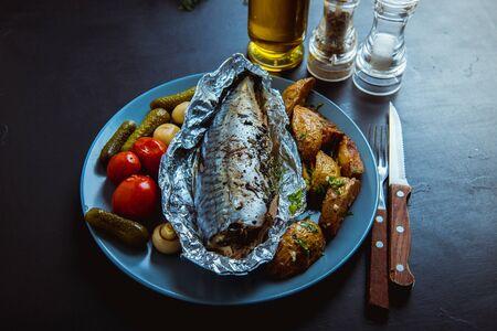 baked mackerel in foil in the oven Standard-Bild