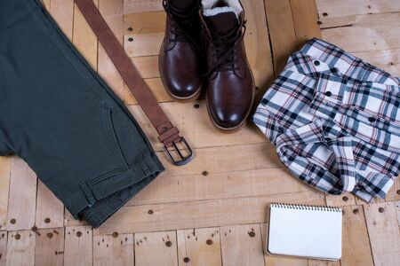 mens stylish winter clothes and Blank white notebook . winter fashion