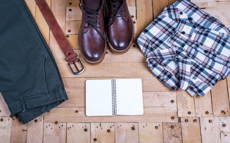 men's stylish winter clothes and Blank white notebook . winter fashion