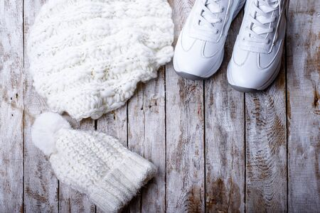 white winter clothes for women on wooden background Reklamní fotografie - 135119004